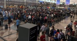 Several hundred fliers grounded overnight in Denver after severe thunderstorms cause flight delays